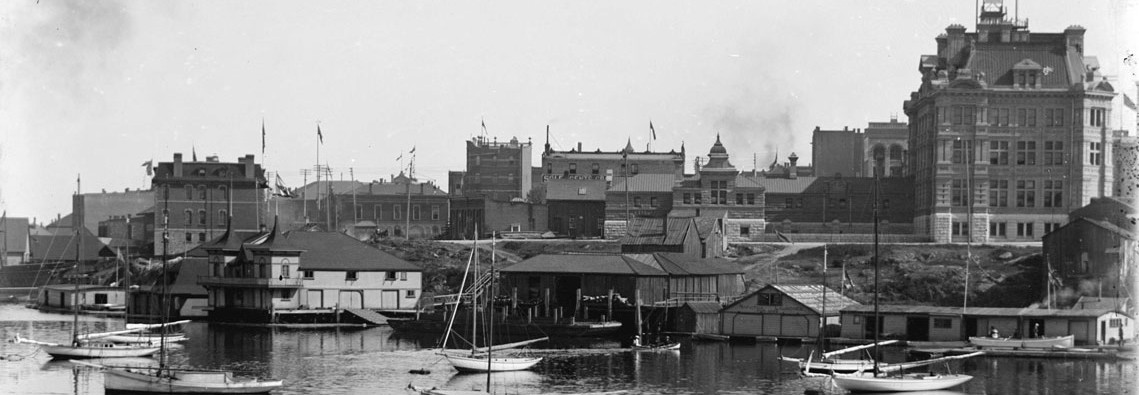 1900 Victoria waterfront, showing post office and boats in inner harbour